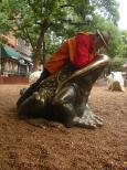 [Frank riding a bronze toad]