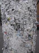 [Close-up of telephone pole with remants of posting]